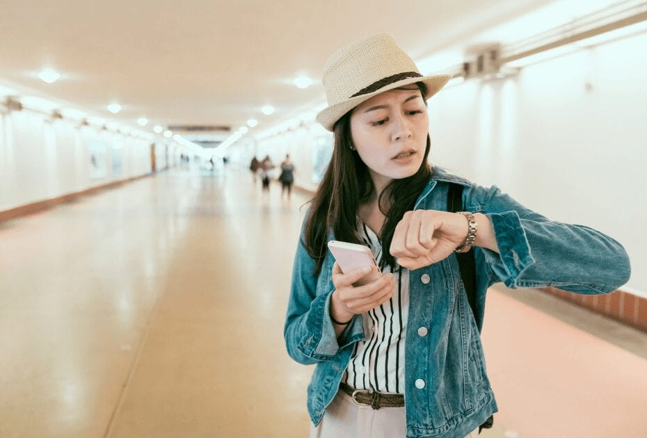 A female backpacker holding her cellphone