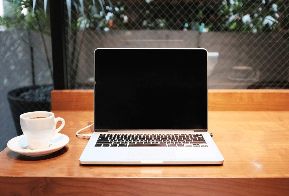 A white tea mug and a macbook