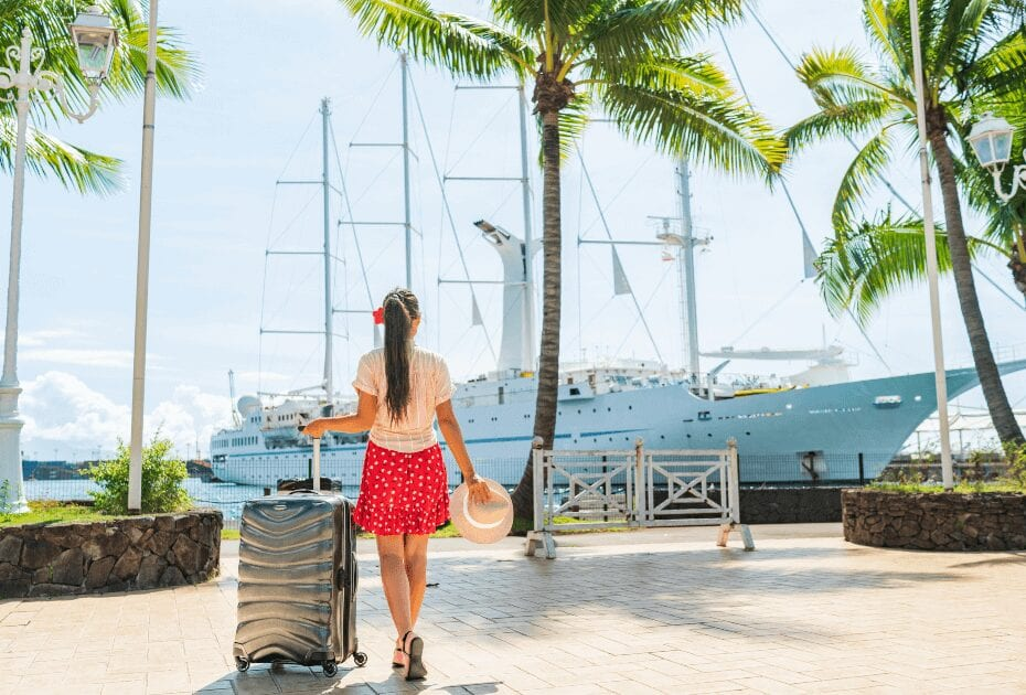 A woman embarking a cruise with luggage