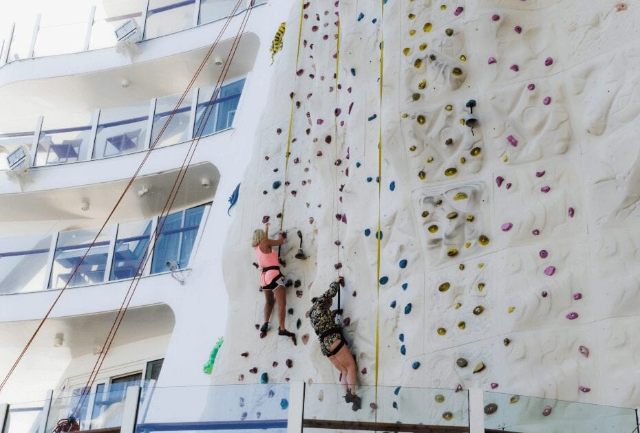 Tourists climbing a wall at a cruise liner