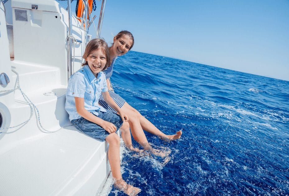 two siblings on board of sailing yacht
