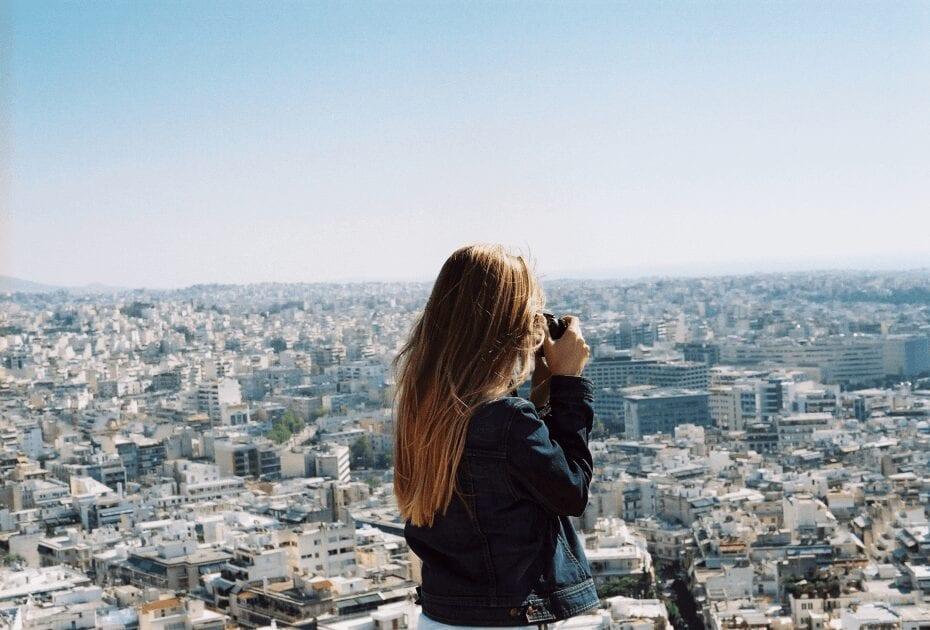 A woman taking photo in Greece