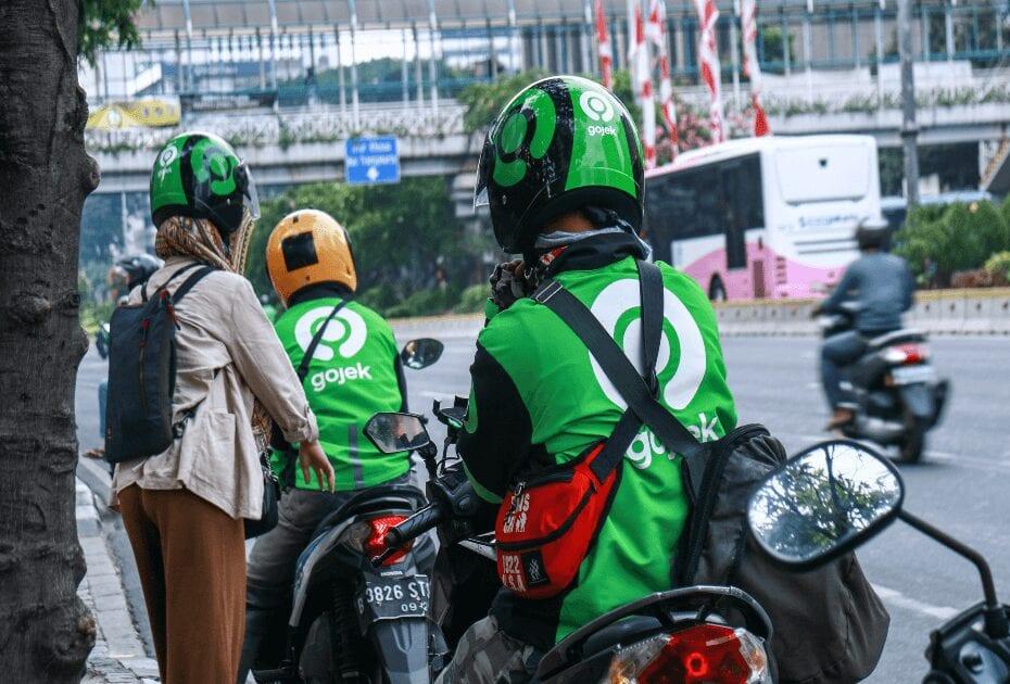 Driver of Gojek, motorcycle taxi, waiting passenger on Jalan MH Thamrin, Central Jakarta.