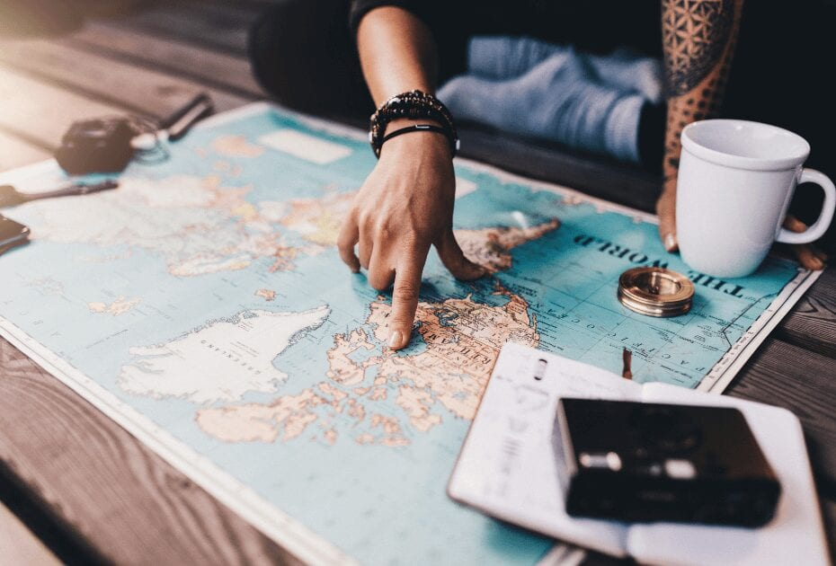Preparation is key when traveling solo - tourist planning vacation help world map