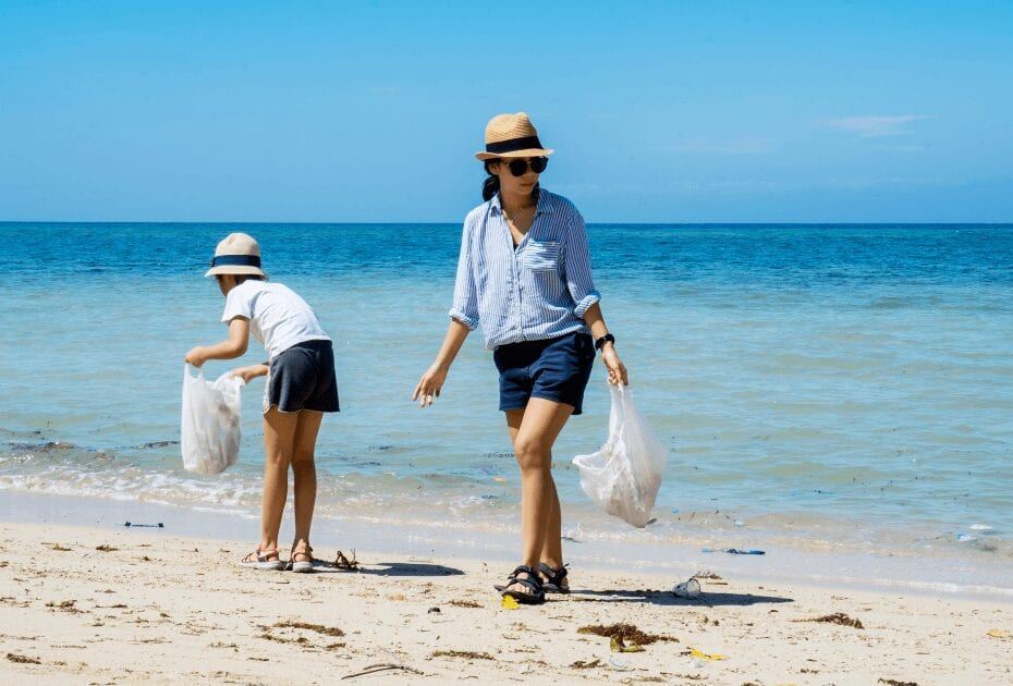 Two volunteers cleaning the beach