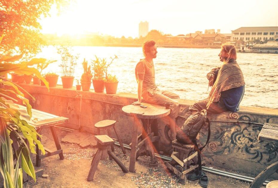 couple best-friends travelers talking sunset