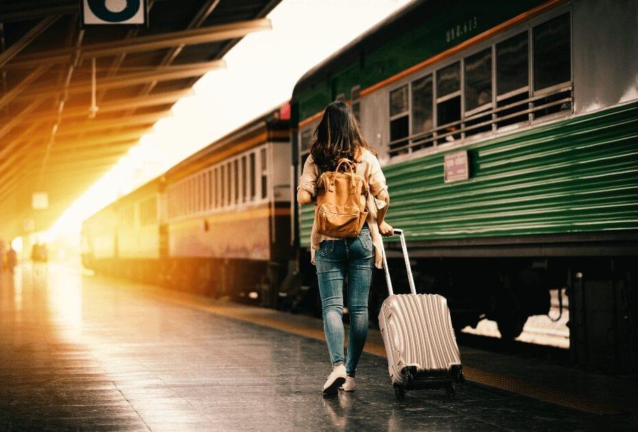 woman traveler tourist walking luggage train